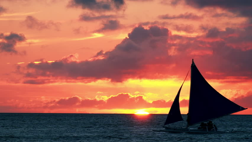 Amazing colors of tropical sunset. Sail boats silhouettes floating on ocean horizon. Boracay island, Philippines summer vacation - HD stock footage clip