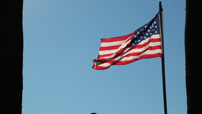 The American Flag Waving Against Blue Sky Background #14419189