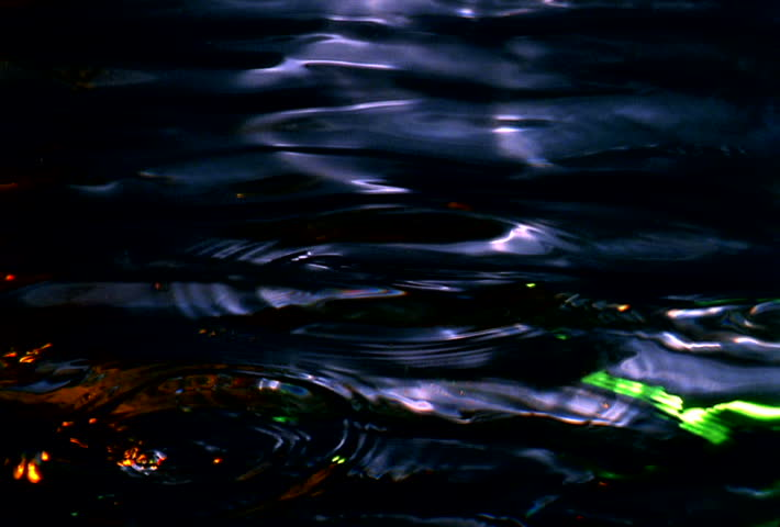 color liquid drops and ripples in water - SD stock footage clip