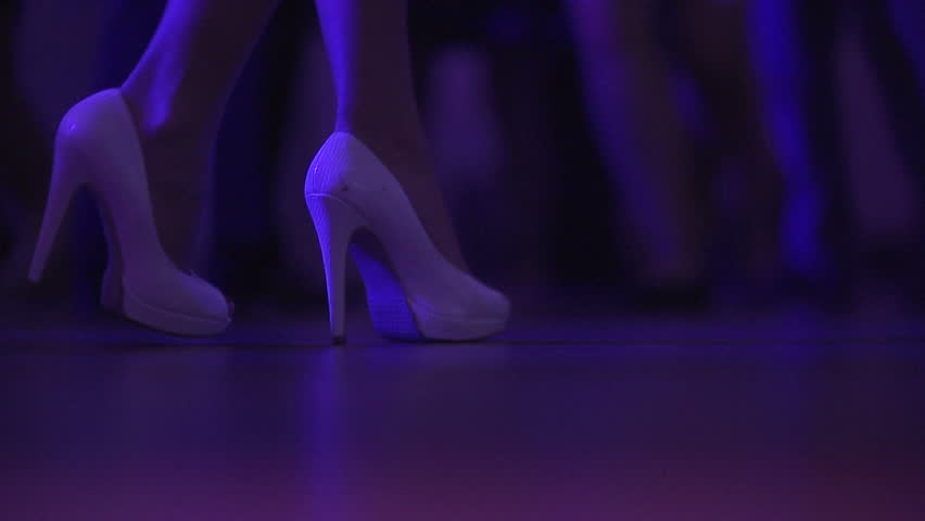 Close up of dancing women and men's feet on the dance floor at the night club or discotheque. - HD stock video clip