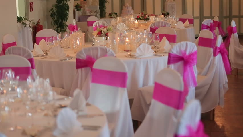 White Chairs At A Wedding Indoor Stock Photo: Outdoor Wedding Settings. Chairs Decorated With Cloth For