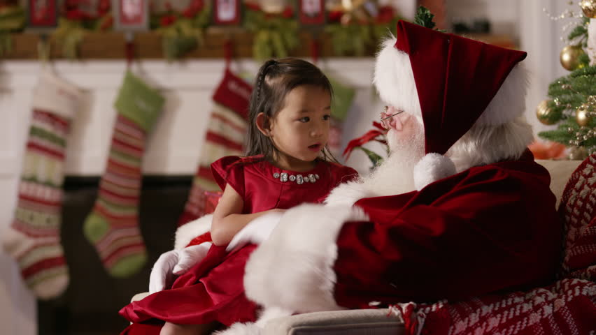 Santa Claus opens a gift with young girl - 4K stock footage clip