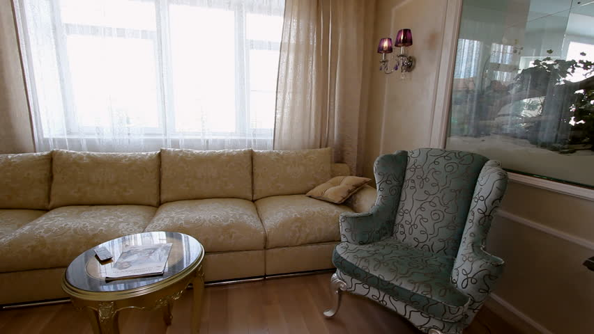 Luxury apartment interior view of beautifully decorated living room with beige sofa and for Living room karaoke