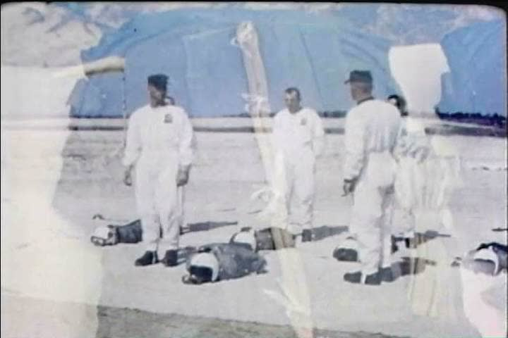 CIRCA 1960s - How to put your parachute, headgear and equipment on correctly in 1966. - SD stock video clip