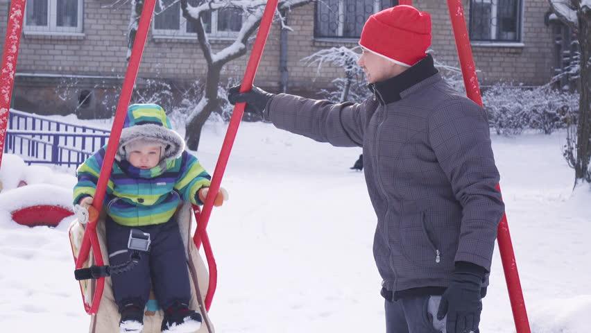 Child on swing in winter   Shutterstock HD Video #14538799