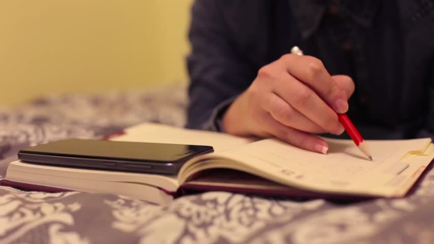 Image result for woman writing in journal