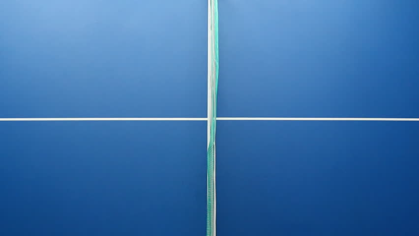 Table Tennis Or Ping Pong Ball Net And Blue Table Above Close Up View