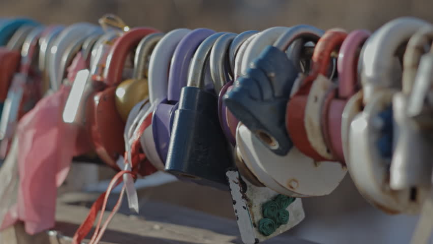 Padlock on the bridge of a loving couple | Shutterstock HD Video #14608243