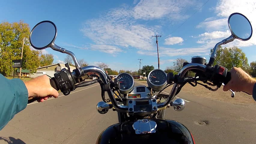 JASPER, ARKANSAS/USA: June 12, 2015- The viewpoint or point of view of someone riding a motorcycle in a small town in middle America.  - HD stock video clip