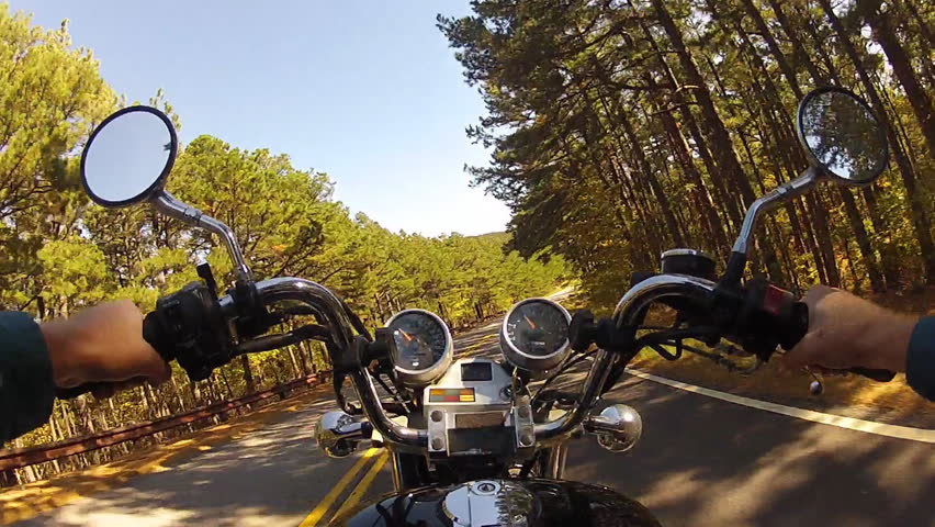 JASPER, ARKANSAS/USA: June 12, 2015- The viewpoint or point of view of a person going for a motorcycle ride on a rural middle American road through a forest.  - HD stock footage clip