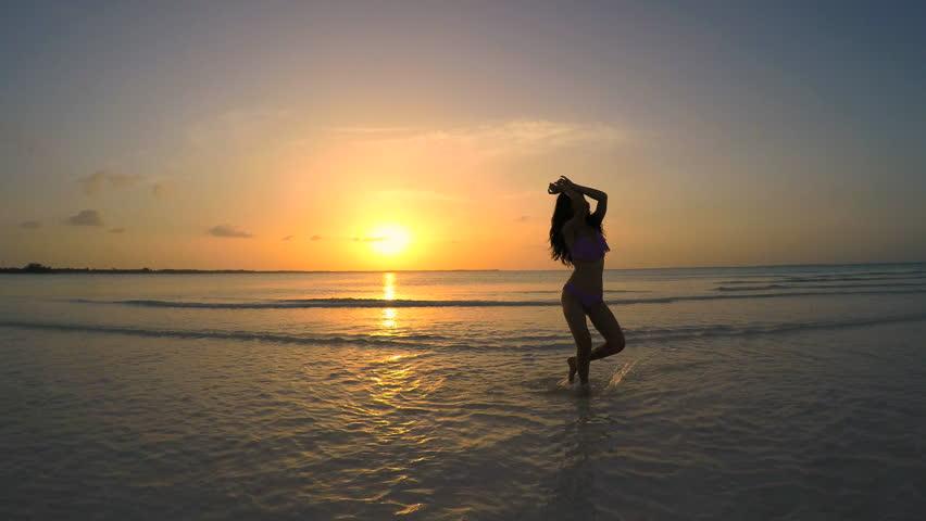 Asian Chinese girl in bikini on the ocean beach - 4K stock footage clip