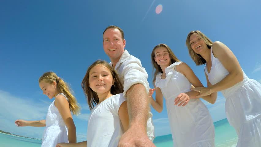 Selfie portrait of Caucasian family enjoying vacation beach | Shutterstock HD Video #14689261