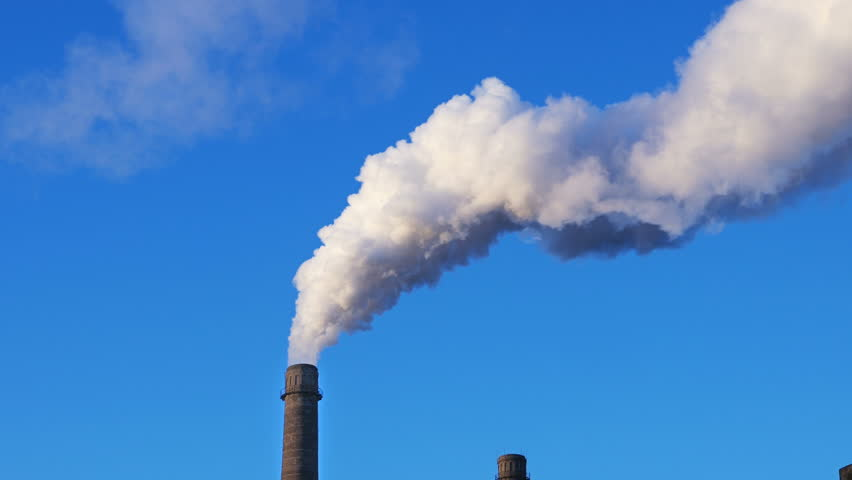 Factory plant smoke stack over blue sky background. Energy generation and air environment pollution industrial scene. 4K UHD video footage. - 4K stock video clip