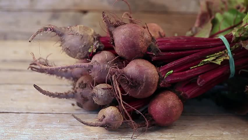 Fresh organic beets just picked from the garden on an old wooden table.