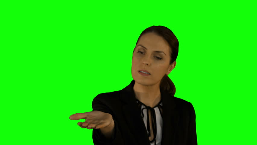 Businesswoman presenting with hand on green screen background | Shutterstock HD Video #14713507