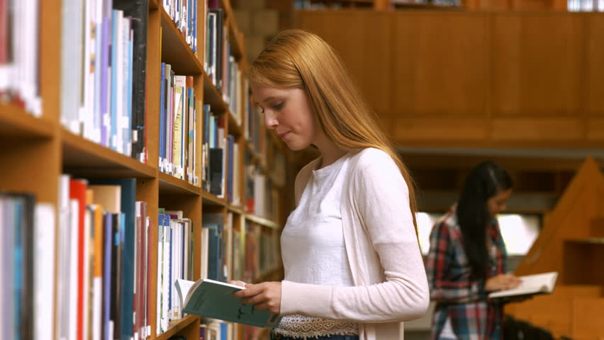 Students reading in a library in the university college - 4K stock video clip