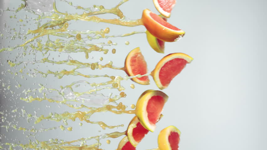 grapefruit slices fly with grapefruit juice, white background, slow motion #14720563