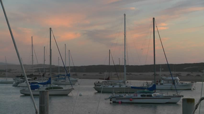 Boats sit in the harbor at Morro Bay, California. - HD stock footage clip