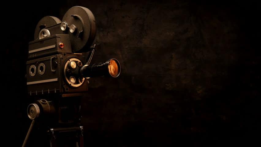 Vintage Hollywood Movie Camera In Front Of Black Backdrop ...