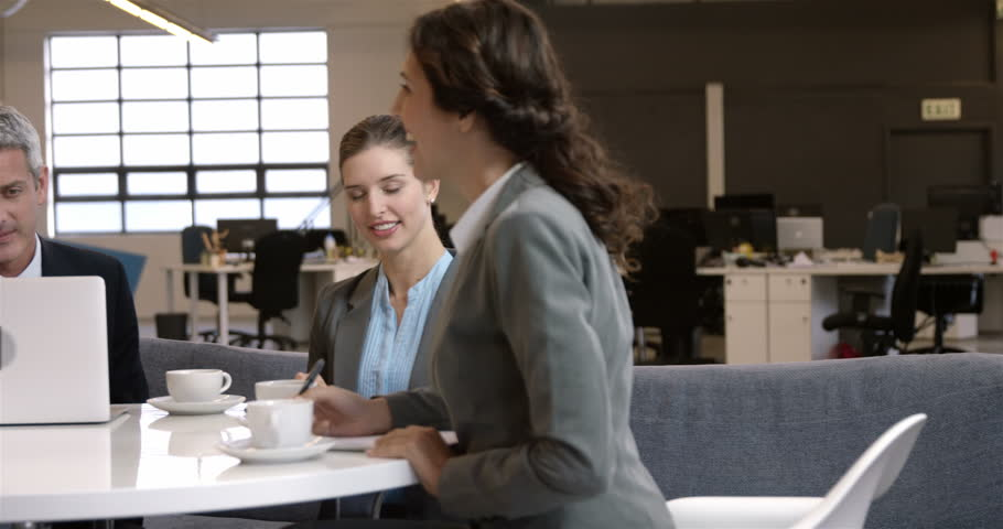 Business people drinking coffee during a meeting - 4K stock video clip