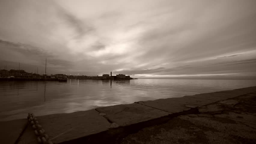 View of the sunset from the pier of Trieste. Trieste Italy. Sepia