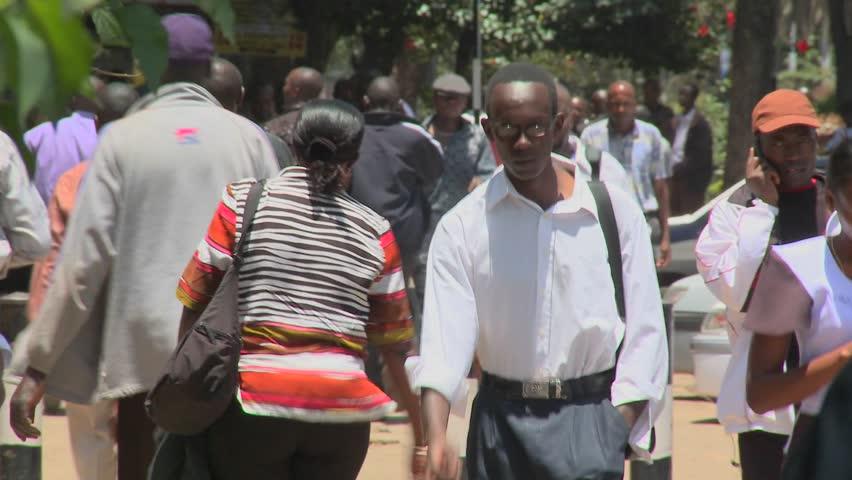 NAIROBI, KENYA - CIRCA 2009:  Pedestrians walk on the streets circa 2009 in Nairobi, Kenia. - HD stock footage clip