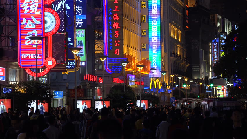 SHANGHAI, CHINA - 31 OCTOBER 2015: Neon lights in a shopping street in Shanghai - 4K stock footage clip