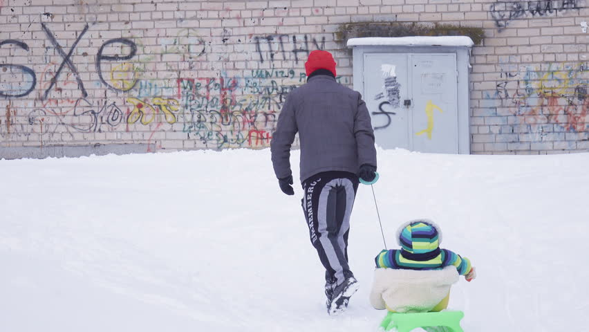 Father and child in snow | Shutterstock HD Video #14863474