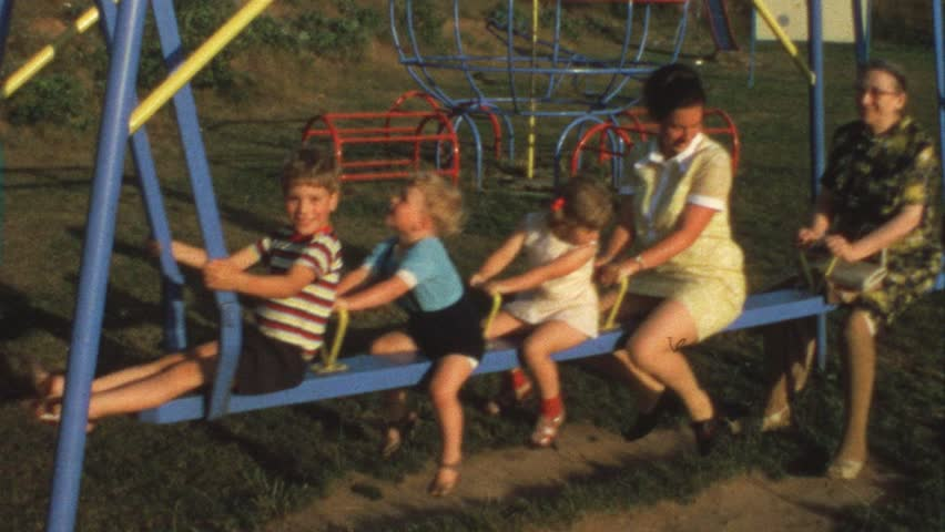 Mother, grandma and children on swing (vintage 8 mm film) - HD stock video clip