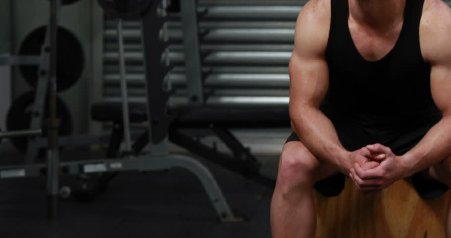 Fit man smiling and showing thumb up at the gym - 4K stock footage clip