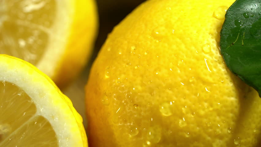 Lemons with leaves under drops water on wooden boards.  4k                       #14960341