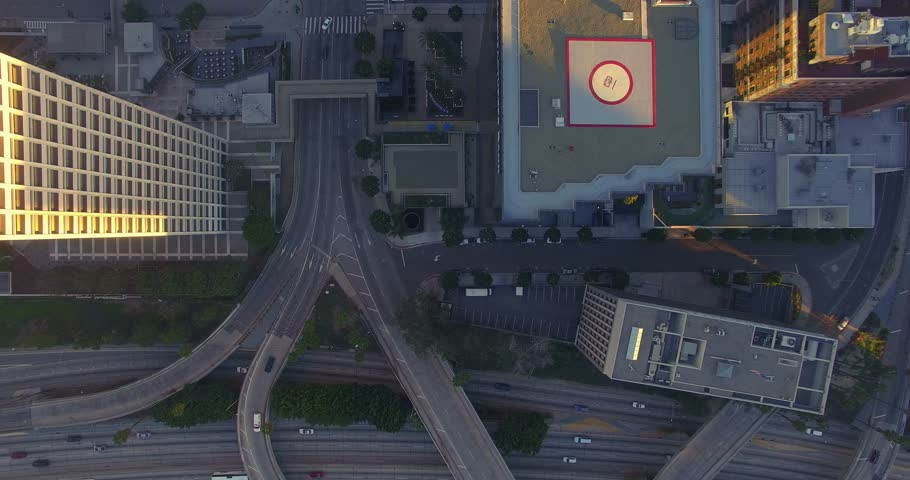Top down aerial vertical view of traffic on 110 freeway in downtown Los Angeles. 4K UHD.