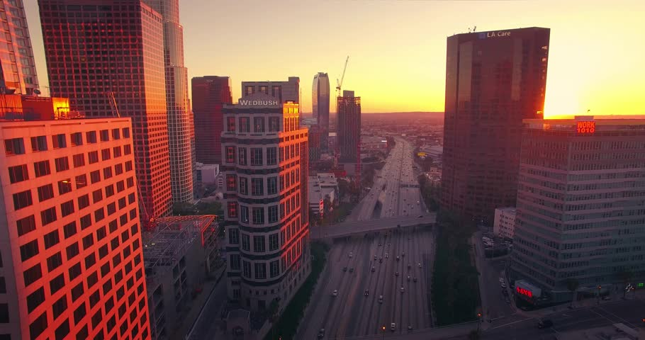 LOS ANGELES: - Circa 2015: Aerial view of downtown Los Angeles skyline at sunset. Camera flying forward. 4K UHD.