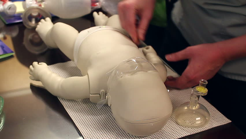 Practicing CPR on child dummy