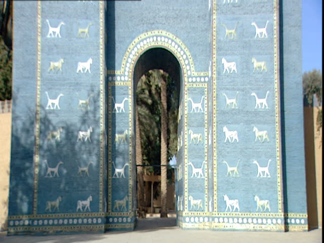 Babylon, Iraq - 2002 - Tilt down of a replica of the Ishtar Gate. The gate shows alternating rows of animals (aurochs and dragons) representing the gods Marduk and Adad.