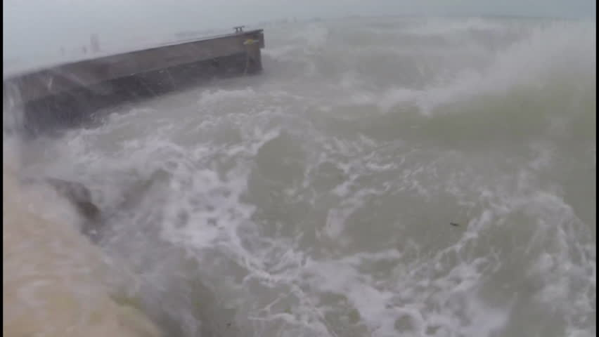 Hurricane storm surge breaks over a pier - HD stock footage clip