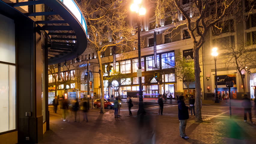 SAN FRANCISCO - 2 MAR: Timelapse view of city streets near Powel St. with people and traffic moving at night, on 2 March 2015 in San Francisco, USA - HD stock video clip