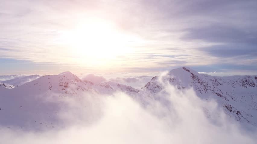Epic Aerial Flight Through Mountain Clouds Towards Sunrise Beautiful Morning Peaks Inspirational Motivational Nature Background UHD 4K