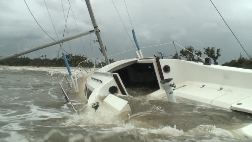Hurricane storm surge engulfs a sailboat that did not seek shelter