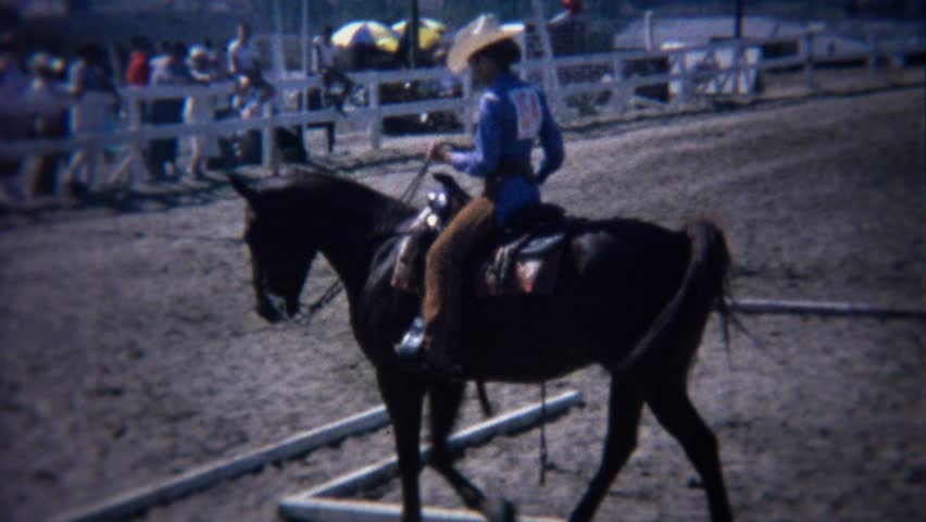 RIVERSIDE, CALIFORNIA 1972: Horse dressage reining event careful stepping obstacle course. - 4K stock footage clip