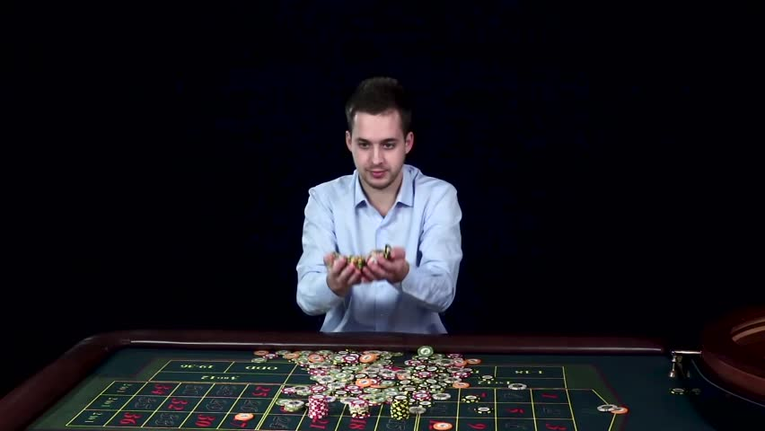 Man smiles hugely as tosses winnings in the air. Black | Shutterstock HD Video #15135535