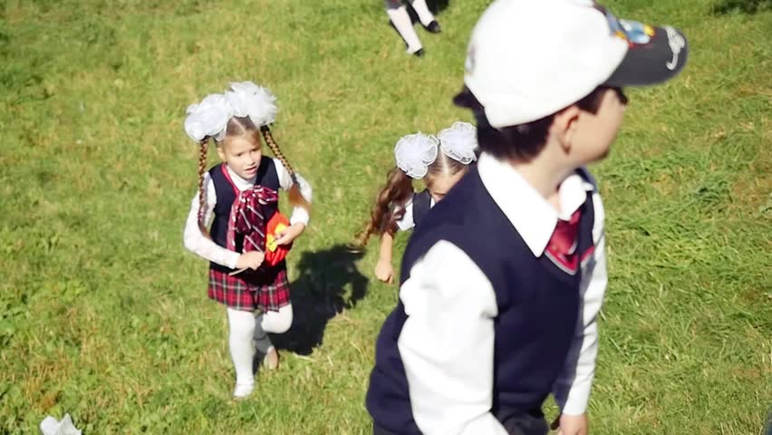 Back to school. Children from elementary school at the school yard in slowmotion. 1920x1080