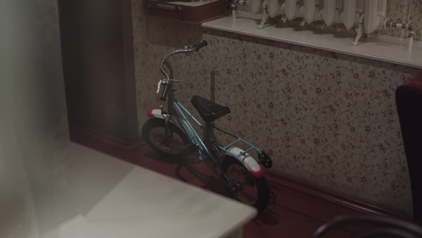 Vintage children's bicycle with a retro turntable in a dark room | Shutterstock HD Video #15170626