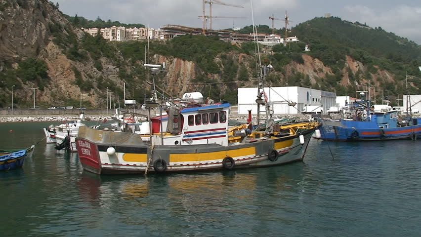 Fishing boats in the port - HD stock video clip