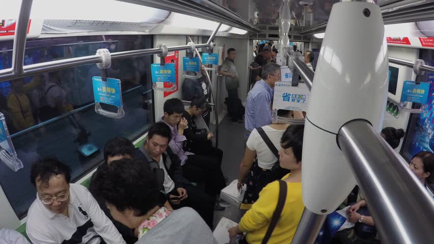 SHANGHAI - NOV 07, 2015: Many people ride in metro train by tunnel with commercial banners. Timelapse   Shutterstock HD Video #15191794