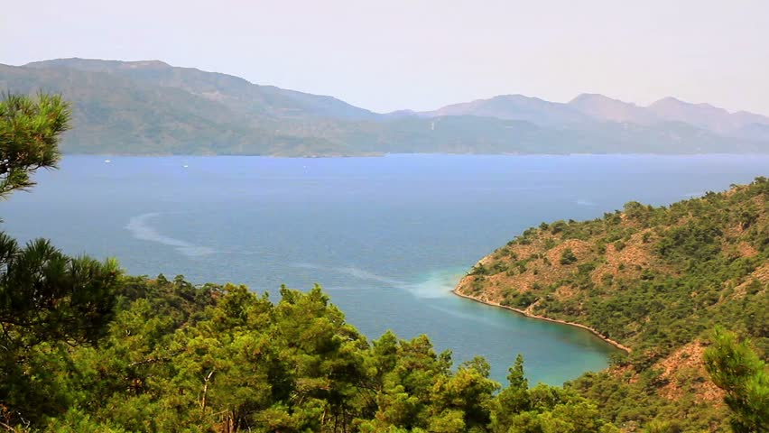View of Amazon Bay Beach in Marmaris, Turkey. Mediterranean Sea and pine trees in Turkey Country
