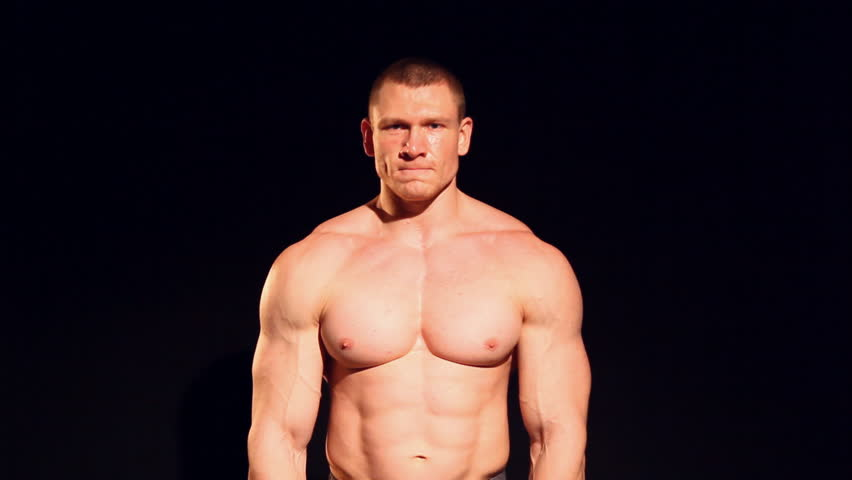 Brutal Strong Muscular Bodybuilder Athletic Man Pumping Up