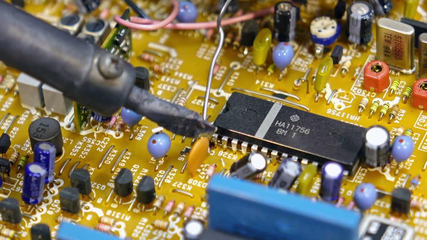 Engineer soldering circuit board. Close-up shot - 4K stock video clip