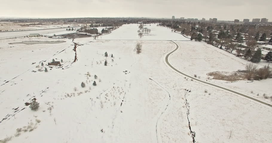 Aerial view of school sport fields and residential area in the Winter.