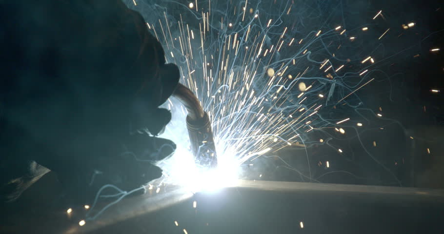 The tip of the welding machine on works during a metal process in the factory - HD stock video clip